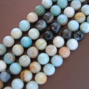 Shop Amazonite Round Beads! Amazonite, Amazonite Beads, Natural Gemstones, Natural Gemstone Beads, Beautiful Beads, Multicolor Beads Smooth Stones Round Beads 10mm Bead | Natural genuine round Amazonite beads for beading and jewelry making.  #jewelry #beads #beadedjewelry #diyjewelry #jewelrymaking #beadstore #beading #affiliate #ad