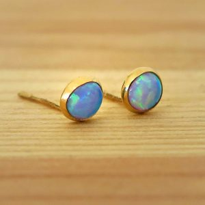 Shop Opal Jewelry! Opal Studs, 14K Gold Blue Opal Earrings, Gold Stud Earrings, 14K Gold Earrings, Solid Gold Earrings, Girls Earrings, October Birthstone | Natural genuine Opal jewelry. Buy crystal jewelry, handmade handcrafted artisan jewelry for women.  Unique handmade gift ideas. #jewelry #beadedjewelry #beadedjewelry #gift #shopping #handmadejewelry #fashion #style #product #jewelry #affiliate #ad