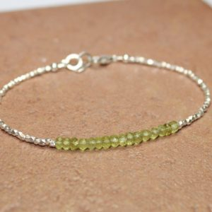 Shop Peridot Bracelets! Peridot Bracelet, Hill Tribe Beads, August Birthstone, Chakra Bracelet, Peridot Jewelry, Pure Silver, Gemstone Bracelet | Natural genuine Peridot bracelets. Buy crystal jewelry, handmade handcrafted artisan jewelry for women.  Unique handmade gift ideas. #jewelry #beadedbracelets #beadedjewelry #gift #shopping #handmadejewelry #fashion #style #product #bracelets #affiliate #ad