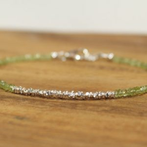 Shop Peridot Bracelets! Skinny Peridot & Hill Tribe Stick Bracelet, Peridot Jewelry, August Birthstone, Minimalist, Gemstone Jewelry | Natural genuine Peridot bracelets. Buy crystal jewelry, handmade handcrafted artisan jewelry for women.  Unique handmade gift ideas. #jewelry #beadedbracelets #beadedjewelry #gift #shopping #handmadejewelry #fashion #style #product #bracelets #affiliate #ad