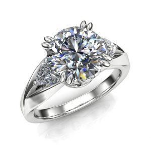 Shop Unique Sapphire Engagement Rings! 2 Carat White Sapphire Engagement Ring, Split Band, Round with Pear Accents | Natural genuine Sapphire rings, simple unique alternative gemstone engagement rings. #rings #jewelry #bridal #wedding #jewelryaccessories #engagementrings #weddingideas #affiliate #ad