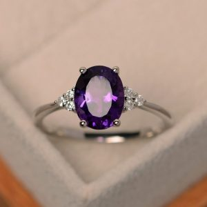 Purple amethyst ring, engagement ring, February birthstone, oval cut, sterling silver | Natural genuine Array jewelry. Buy handcrafted artisan wedding jewelry.  Unique handmade bridal jewelry gift ideas. #jewelry #beadedjewelry #gift #crystaljewelry #shopping #handmadejewelry #wedding #bridal #jewelry #affiliate #ad