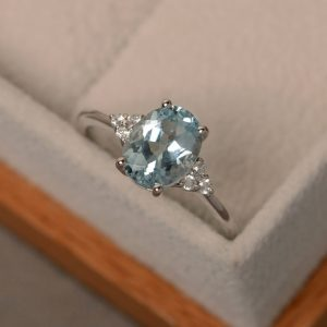 Shop Aquamarine Rings! Aquamarine ring, oval blue aquamarine ring, natural blue gemstone, March birthstone, engagement ring | Natural genuine Aquamarine rings, simple unique alternative gemstone engagement rings. #rings #jewelry #bridal #wedding #jewelryaccessories #engagementrings #weddingideas #affiliate #ad