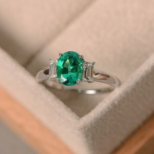 Lab emerald ring, May birthstone, three stone ring, oval emerald, sterling silver, engagement ring | Natural genuine Gemstone rings, simple unique alternative gemstone engagement rings. #rings #jewelry #bridal #wedding #jewelryaccessories #engagementrings #weddingideas #affiliate #ad