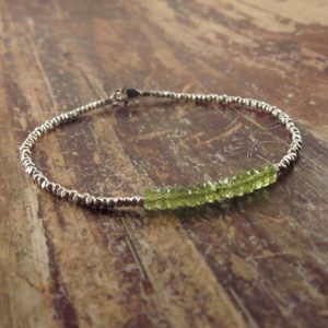 Shop Peridot Jewelry! Peridot Bracelet, August Birthstone Bracelet, Silver Beaded Bracelets for Women, Heart Chakra Bracelet, Peridot Jewelry, Minimalist Bracelet | Natural genuine Peridot jewelry. Buy crystal jewelry, handmade handcrafted artisan jewelry for women.  Unique handmade gift ideas. #jewelry #beadedjewelry #beadedjewelry #gift #shopping #handmadejewelry #fashion #style #product #jewelry #affiliate #ad