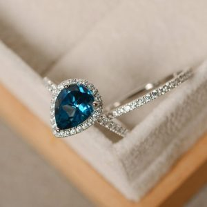 Blue topaz ring, pear engagement ring, sterling silver, pear shaped ring | Natural genuine Topaz rings, simple unique alternative gemstone engagement rings. #rings #jewelry #bridal #wedding #jewelryaccessories #engagementrings #weddingideas #affiliate #ad