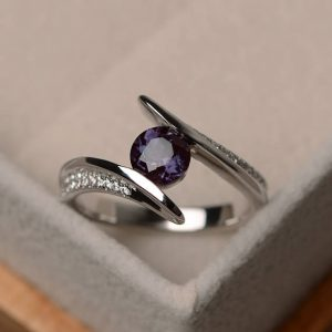 Lab Alexandrite Ring, Round Cut Engagement Ring, Bezel Setting, Sterling Silver | Natural genuine Gemstone rings, simple unique alternative gemstone engagement rings. #rings #jewelry #bridal #wedding #jewelryaccessories #engagementrings #weddingideas #affiliate #ad