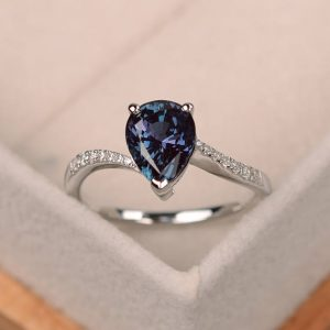 Shop Alexandrite Jewelry! Alexandrite Ring, pear shaped engagement ring, silver | Natural genuine Alexandrite jewelry. Buy handcrafted artisan wedding jewelry.  Unique handmade bridal jewelry gift ideas. #jewelry #beadedjewelry #gift #crystaljewelry #shopping #handmadejewelry #wedding #bridal #jewelry #affiliate #ad