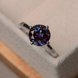 Shop Alexandrite Jewelry! Alexandrite ring, round cut engagement ring, solitaire ring silver | Natural genuine Alexandrite jewelry. Buy handcrafted artisan wedding jewelry.  Unique handmade bridal jewelry gift ideas. #jewelry #beadedjewelry #gift #crystaljewelry #shopping #handmadejewelry #wedding #bridal #jewelry #affiliate #ad