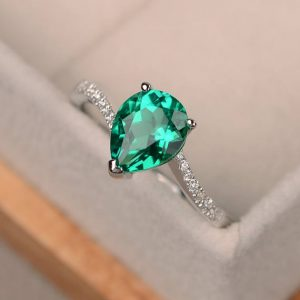 Shop Emerald Engagement Rings! Emerald ring silver, pear cut engagement rings, green gemstone ring, May birthstone | Natural genuine Emerald rings, simple unique alternative gemstone engagement rings. #rings #jewelry #bridal #wedding #jewelryaccessories #engagementrings #weddingideas #affiliate #ad