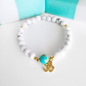 Shop Healing Stone Bracelets! Mala Bracelet – Wrist Mala – Healing Howlite Bead Yoga Bracelet with an OM charm | Natural genuine Gemstone bracelets. Buy crystal jewelry, handmade handcrafted artisan jewelry for women.  Unique handmade gift ideas. #jewelry #beadedbracelets #beadedjewelry #gift #shopping #handmadejewelry #fashion #style #product #bracelets #affiliate #ad