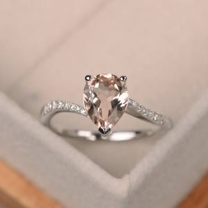 Shop Morganite Jewelry! Natural Morganite Engagement Ring, Pear Shaped Ring, Gemstone Ring Silver | Natural genuine Morganite jewelry. Buy handcrafted artisan wedding jewelry.  Unique handmade bridal jewelry gift ideas. #jewelry #beadedjewelry #gift #crystaljewelry #shopping #handmadejewelry #wedding #bridal #jewelry #affiliate #ad