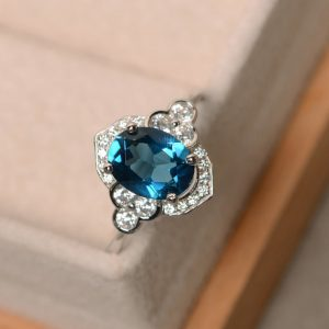 London blue topaz ring, oval cut, blue gemstone, wedding ring, sterling silver | Natural genuine Topaz rings, simple unique alternative gemstone engagement rings. #rings #jewelry #bridal #wedding #jewelryaccessories #engagementrings #weddingideas #affiliate #ad