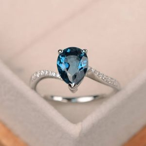 London blue topaz ring, pear shaped engagement ring, silver ring | Natural genuine Gemstone rings, simple unique alternative gemstone engagement rings. #rings #jewelry #bridal #wedding #jewelryaccessories #engagementrings #weddingideas #affiliate #ad