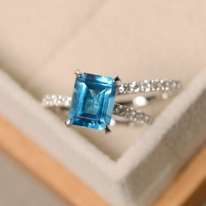 Swiss blue topaz ring, engagement ring, blue gemstone topaz ring, wedding ring,emerald cut ring | Natural genuine Gemstone rings, simple unique alternative gemstone engagement rings. #rings #jewelry #bridal #wedding #jewelryaccessories #engagementrings #weddingideas #affiliate #ad