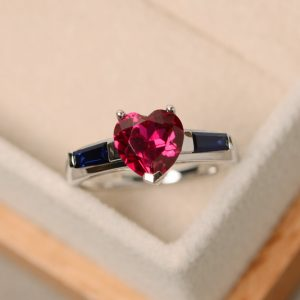 Shop Ruby Rings! Heart cut ruby ring, engagement ring, red ruby ring, ruby ring | Natural genuine Ruby rings, simple unique alternative gemstone engagement rings. #rings #jewelry #bridal #wedding #jewelryaccessories #engagementrings #weddingideas #affiliate #ad