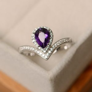 Shop Unique Amethyst Engagement Rings! Amethyst ring, pear cut amethyst, silver, engagement ring | Natural genuine Amethyst rings, simple unique alternative gemstone engagement rings. #rings #jewelry #bridal #wedding #jewelryaccessories #engagementrings #weddingideas #affiliate #ad