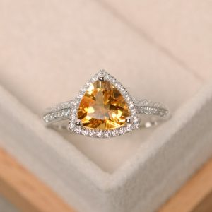 Shop Citrine Rings! Citrine ring, November birthstone ring, triangle cut citrine, natural citrine, engagement ring, trillion cut ring | Natural genuine Citrine rings, simple unique alternative gemstone engagement rings. #rings #jewelry #bridal #wedding #jewelryaccessories #engagementrings #weddingideas #affiliate #ad