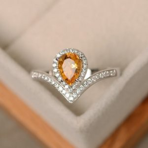 Shop Citrine Rings! Citrine ring, yellow gemstone, pear cut, engagement ring, silver | Natural genuine Citrine rings, simple unique alternative gemstone engagement rings. #rings #jewelry #bridal #wedding #jewelryaccessories #engagementrings #weddingideas #affiliate #ad