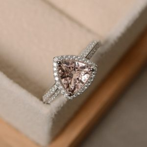 Shop Morganite Engagement Rings! Morganite engagement ring, morganite ring, sterling silver, trillion cut ring | Natural genuine Morganite rings, simple unique alternative gemstone engagement rings. #rings #jewelry #bridal #wedding #jewelryaccessories #engagementrings #weddingideas #affiliate #ad