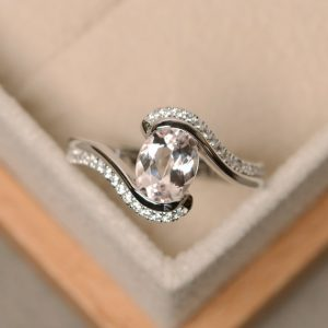 Shop Morganite Engagement Rings! Morganite ring, pink morganite, oval cut ring, morganite, morganite engagement ring | Natural genuine Morganite rings, simple unique alternative gemstone engagement rings. #rings #jewelry #bridal #wedding #jewelryaccessories #engagementrings #weddingideas #affiliate #ad