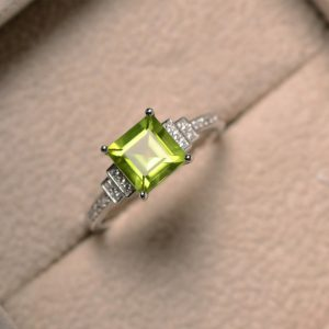 Natural peridot ring, square cut, engagement, promise ring, August birthstone, sterling silver | Natural genuine Peridot rings, simple unique alternative gemstone engagement rings. #rings #jewelry #bridal #wedding #jewelryaccessories #engagementrings #weddingideas #affiliate #ad
