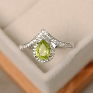 Shop Peridot Rings! Peridot ring, pear cut , engagement ring, natural peridot | Natural genuine Peridot rings, simple unique alternative gemstone engagement rings. #rings #jewelry #bridal #wedding #jewelryaccessories #engagementrings #weddingideas #affiliate #ad
