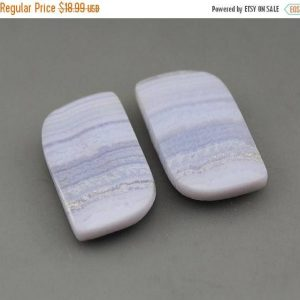 Shop Agate Cabochons! Blue Lace Agate Matching Pair Cabochons | Natural genuine stones & crystals in various shapes & sizes. Buy raw cut, tumbled, or polished gemstones for making jewelry or crystal healing energy vibration raising reiki stones. #crystals #gemstones #crystalhealing #crystalsandgemstones #energyhealing #affiliate #ad