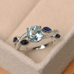 Shop Aquamarine Rings! Aquamarine ring, leaf ring, sterling silver, aquamarine engagement ring, natural aquamarine | Natural genuine Aquamarine rings, simple unique alternative gemstone engagement rings. #rings #jewelry #bridal #wedding #jewelryaccessories #engagementrings #weddingideas #affiliate #ad