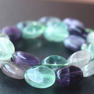 Shop Fluorite Beads! Natural Rainbow Genuine Fluorite Oval Shape Beads,15 inches one starand | Natural genuine beads Fluorite beads for beading and jewelry making.  #jewelry #beads #beadedjewelry #diyjewelry #jewelrymaking #beadstore #beading #affiliate #ad