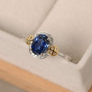 Shop Unique Sapphire Engagement Rings! Sapphire ring, yellow gold, oval cut ring, engagement, oval cut sapphire, cross ring | Natural genuine Sapphire rings, simple unique alternative gemstone engagement rings. #rings #jewelry #bridal #wedding #jewelryaccessories #engagementrings #weddingideas #affiliate #ad
