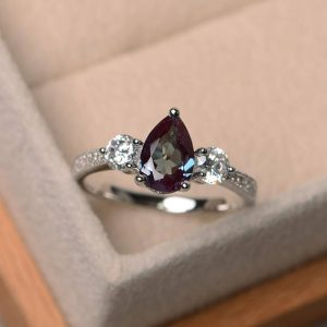 Shop Alexandrite Rings! Lab Alexandrite Ring, Wedding Ring, pear Cut Ring, Color Change Gemstone Ring, Sterling Silver Ring, June Birthstone Ring | Natural genuine Alexandrite rings, simple unique alternative gemstone engagement rings. #rings #jewelry #bridal #wedding #jewelryaccessories #engagementrings #weddingideas #affiliate #ad