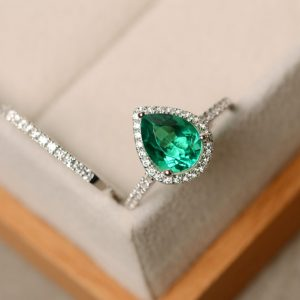 Shop Emerald Engagement Rings! Emerald ring, engagement ring, pear cut ring, emerald | Natural genuine Emerald rings, simple unique alternative gemstone engagement rings. #rings #jewelry #bridal #wedding #jewelryaccessories #engagementrings #weddingideas #affiliate #ad