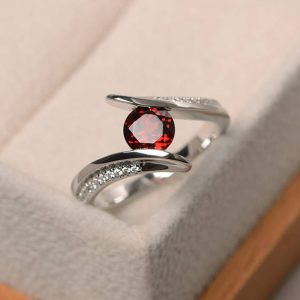 Shop Garnet Rings! Garnet wedding ring, natural red garnet ring, January birthstone ring, sterling silver ring, red gemstone ring, round cut gemstone | Natural genuine Garnet rings, simple unique alternative gemstone engagement rings. #rings #jewelry #bridal #wedding #jewelryaccessories #engagementrings #weddingideas #affiliate #ad