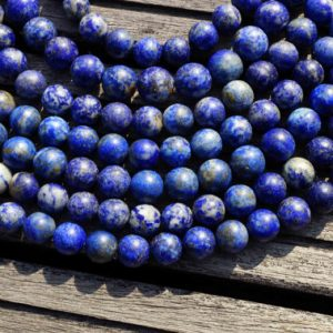 Shop Lapis Lazuli Round Beads! Matte Lapis Lazuli 11-12mm Round Beads (etb00138) | Natural genuine round Lapis Lazuli beads for beading and jewelry making.  #jewelry #beads #beadedjewelry #diyjewelry #jewelrymaking #beadstore #beading #affiliate #ad