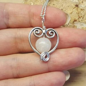 Shop Moonstone Necklaces! Moonstone heart Pendant. Crystal Reiki jewelry uk. June's Birthstone. White 10mm stone. Heart frame necklace. Empowered crystals | Natural genuine Moonstone necklaces. Buy crystal jewelry, handmade handcrafted artisan jewelry for women.  Unique handmade gift ideas. #jewelry #beadednecklaces #beadedjewelry #gift #shopping #handmadejewelry #fashion #style #product #necklaces #affiliate #ad