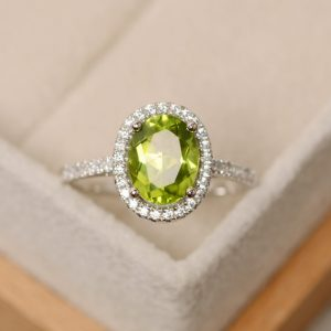 Peridot ring, halo engagement ring, natural peridot, oval cut peridot ring | Natural genuine Gemstone rings, simple unique alternative gemstone engagement rings. #rings #jewelry #bridal #wedding #jewelryaccessories #engagementrings #weddingideas #affiliate #ad
