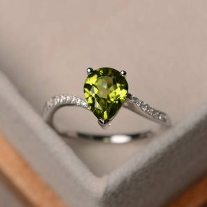 Natural Peridot Ring, Peat Cut Engagement Ring, Sterling Silver Ring, Green Gemstone Ring | Natural genuine Gemstone rings, simple unique alternative gemstone engagement rings. #rings #jewelry #bridal #wedding #jewelryaccessories #engagementrings #weddingideas #affiliate #ad