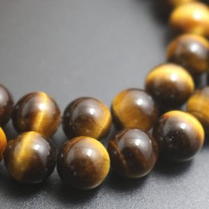 Shop Tiger Eye Round Beads! Natural Aa Yellow Tigereye Beads, 6mm / 8mm / 10mm / 12mm Smooth And Round Stone Beads, 15 Inches One Starand | Natural genuine round Tiger Eye beads for beading and jewelry making.  #jewelry #beads #beadedjewelry #diyjewelry #jewelrymaking #beadstore #beading #affiliate #ad