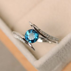 Shop Unique Engagement Rings Under $100! London blue topaz ring, engagement ring, wedding ring, sterling silver | Natural genuine Amethyst rings, simple unique alternative gemstone engagement rings. #rings #jewelry #bridal #wedding #jewelryaccessories #engagementrings #weddingideas #affiliate #ad