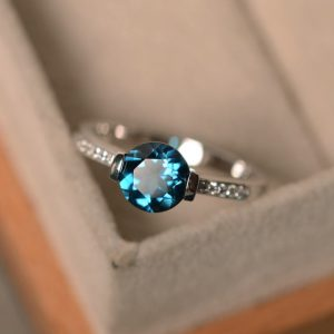 Shop Topaz Jewelry! London blue topaz ring, blue gemstone ring, round cut ring, engagement ring | Natural genuine gemstone jewelry in modern, chic, boho, elegant styles. Buy crystal handmade handcrafted artisan art jewelry & accessories. #jewelry #beaded #beadedjewelry #product #gifts #shopping #style #fashion #product