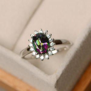 Shop Unique Engagement Rings Under $100! Rainbow topaz ring, oval cut ring, halo ring, mystic topaz ring, silver, engagement ring | Natural genuine Amethyst rings, simple unique alternative gemstone engagement rings. #rings #jewelry #bridal #wedding #jewelryaccessories #engagementrings #weddingideas #affiliate #ad