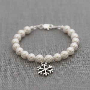 Shop Pearl Bracelets! Flower Girl Snowflake Bracelet, Winter Wedding Pearl Jewelry, Snowflake Pearl Bracelet, Bridesmaid Flower Girl Snowflake Jewelry | Natural genuine Pearl bracelets. Buy handcrafted artisan wedding jewelry.  Unique handmade bridal jewelry gift ideas. #jewelry #beadedbracelets #gift #crystaljewelry #shopping #handmadejewelry #wedding #bridal #bracelets #affiliate #ad