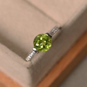 Shop Peridot Rings! Natural Peridot Ring, August Birthstone, Sterling Silver, Engagement Ring, Promise Ring | Natural genuine Peridot rings, simple unique alternative gemstone engagement rings. #rings #jewelry #bridal #wedding #jewelryaccessories #engagementrings #weddingideas #affiliate #ad