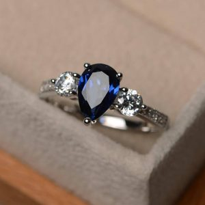 Shop Sapphire Rings! Blue gemstone ring, lab blue sapphire ring, wedding ring, pear cut ring, sterling silver ring, September birthstone ring | Natural genuine Sapphire rings, simple unique alternative gemstone engagement rings. #rings #jewelry #bridal #wedding #jewelryaccessories #engagementrings #weddingideas #affiliate #ad