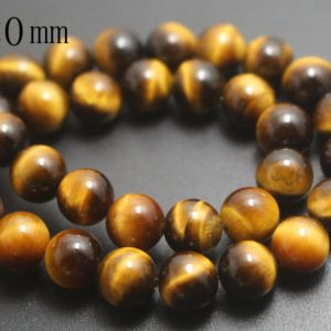 Shop Tiger Eye Round Beads! 20mm Natural AA Yellow Tigereye Beads,Smooth and Round Stone Beads,15 inches one starand | Natural genuine round Tiger Eye beads for beading and jewelry making.  #jewelry #beads #beadedjewelry #diyjewelry #jewelrymaking #beadstore #beading #affiliate #ad