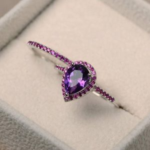 Shop Unique Amethyst Engagement Rings! Natural amethyst ring, pear cut engagement ring, February birthstone, purple gemstone, sterling silver, bridal sets | Natural genuine Amethyst rings, simple unique alternative gemstone engagement rings. #rings #jewelry #bridal #wedding #jewelryaccessories #engagementrings #weddingideas #affiliate #ad