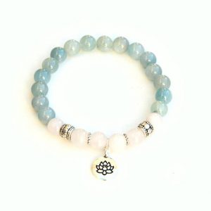 Shop Aquamarine Bracelets! Aquamarine bracelet with Rose Quartz & Lotus charm | Natural genuine Aquamarine bracelets. Buy crystal jewelry, handmade handcrafted artisan jewelry for women.  Unique handmade gift ideas. #jewelry #beadedbracelets #beadedjewelry #gift #shopping #handmadejewelry #fashion #style #product #bracelets #affiliate #ad