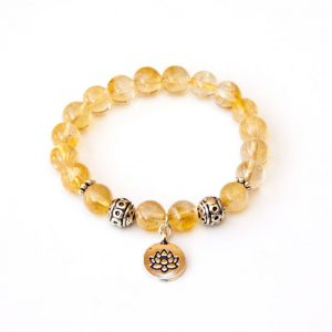Shop Citrine Bracelets! Citrine bracelet with Lotus charm | Natural genuine Citrine bracelets. Buy crystal jewelry, handmade handcrafted artisan jewelry for women.  Unique handmade gift ideas. #jewelry #beadedbracelets #beadedjewelry #gift #shopping #handmadejewelry #fashion #style #product #bracelets #affiliate #ad