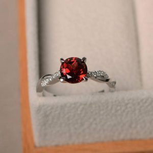 Engagement rings, natural garnet rings, January birthstone, round cut red gemstone, sterling silver rings, lovely rings | Natural genuine Array rings, simple unique alternative gemstone engagement rings. #rings #jewelry #bridal #wedding #jewelryaccessories #engagementrings #weddingideas #affiliate #ad